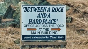 Rock and hard place sign