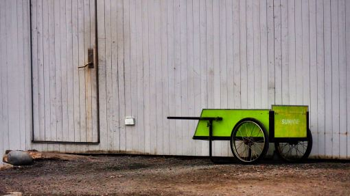 Wheelbarrow on wall